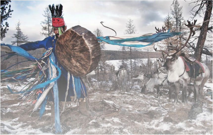 shaman dressed in blue, drumming and dancing with reindeer and snow